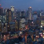 brightly lit buildings of Osaka at night, Japan